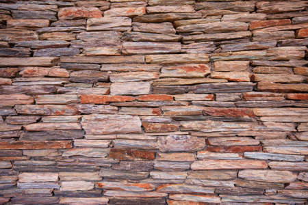 Natural slate stone building wall photo