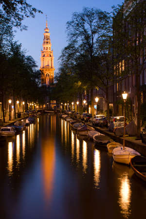 dutch canal house: Church tower, lights and canal in Amsterdam Stock Photo