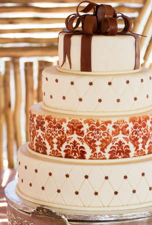 Layered white wedding cake with chocolate detail on silver serving dish Stock Photo - 9635990