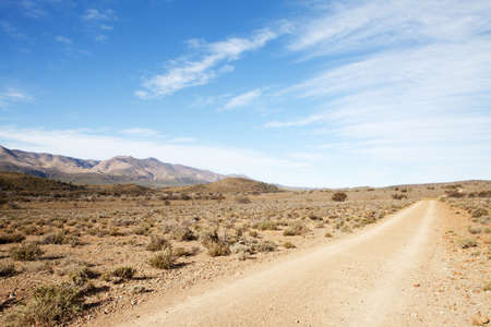 south africa soil: Dirt road in dry semi-desert region leading away from the viewer Stock Photo