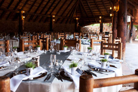 wedding table setting: Wedding reception decor under thatch roof