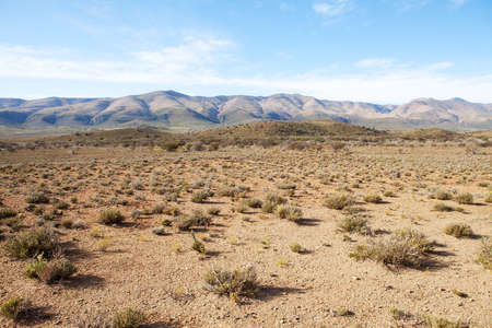 south africa soil: Semi-desert region in South Africa with mountains and blue sky Stock Photo