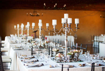 wedding decoration: Wedding reception hall with decorated tables, selective focus Stock Photo