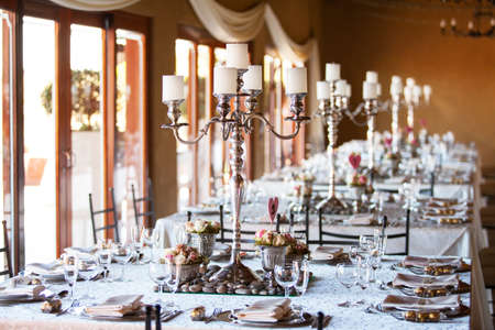 candelabra: Decorated wedding reception hall with flowers and candles