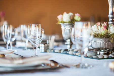 wedding reception: Decorated table with glassware and cutlery at a wedding reception Stock Photo