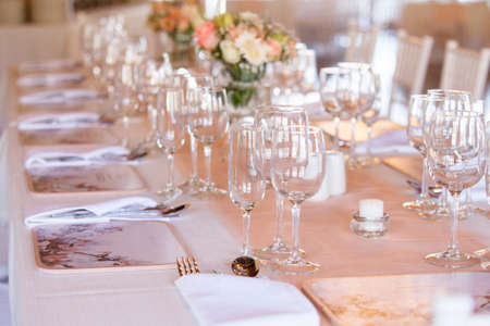 candelabra: Champaigne and wine glasses on a decorated table at wedding reception