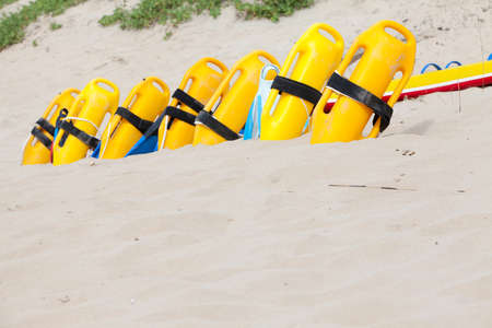 lifesaving: Row of lifesaving floatation devices on the beach