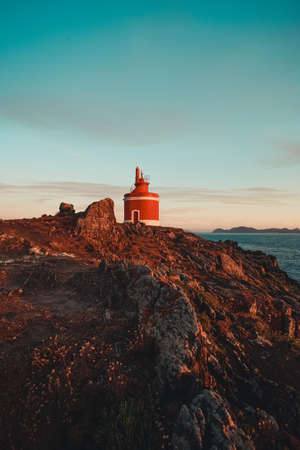 Red lighthouse during the sunset in Spain