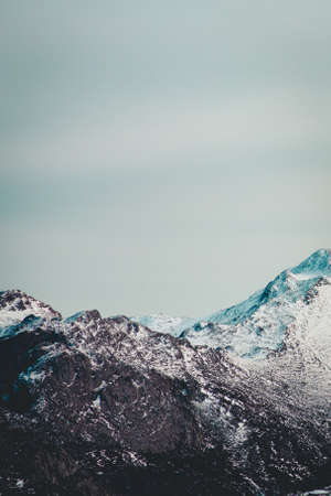 A super close up of a mountain range with snow in the peak
