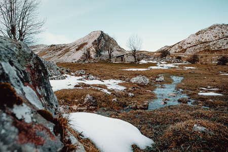 A cabin in the top of the lakes of covadonga during winter with snow and copy space