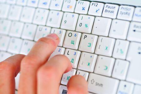 Fingers typing on russian keyboard photo