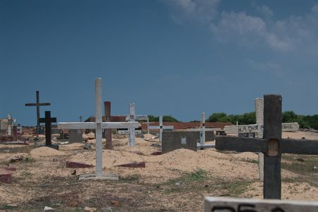 derelict: deserted derelict cemetary next to the ocean Stock Photo