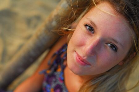 Beautiful young blond girl smiling looking up at camera Stock Photo - 4623080
