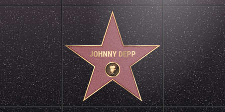 Warsaw, Poland - May 17, 2020: Hollywood star on celebrity walk of fame boulevard. Johnny Depp iconic movie actor star name on celebrity walk of fame on black floor background with light texture
