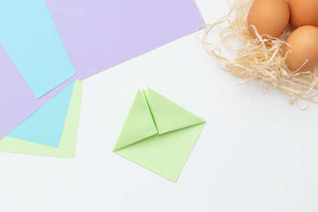 DIY Childrens Easter craft bunny with an egg. Step 5. Easter paper step by step instructions. Happy bunny holds egg. Childrens Art Project, needlework, crafts for children, springtime.