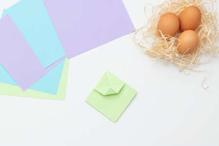 DIY Children's Easter craft bunny with an egg. Step 7. Easter paper step by step instructions. Happy bunny holds egg. Children's Art Project, needlework, crafts for children, springtime