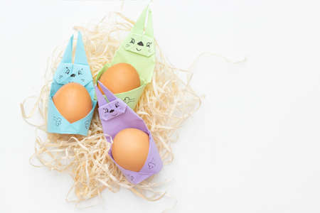 DIY Children's Easter craft bunny with an egg. Easter paper step by step instructions. Happy bunny holds egg. Children's Art Project, needlework, crafts for children, springtime