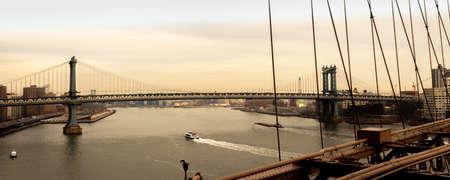 sunset on the Manhattan bridge with a speedboat