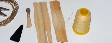 craft tools and bamboo cut into strips to make reeds for the bassoon instrument