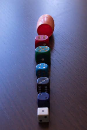 kite and dice of different color and size where the scores from one to six come out Imagens