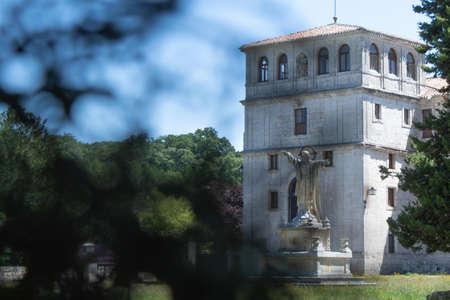 Tower of the Monastery of San Pedro de Cardena in Burgos, Castilla y Leon, Spain behind the trees