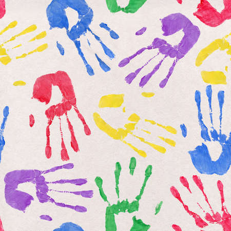 handprints: Background depicting colorful paint handprints on newsprint paper  Seamlessly Repeatable