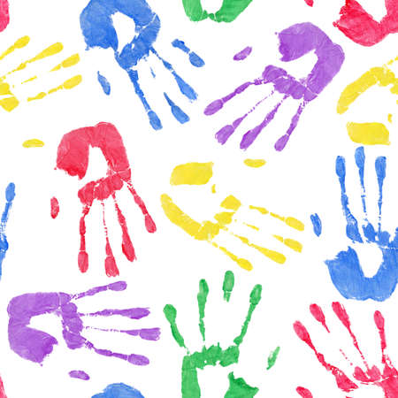handprints: Background depicting colorful paint handprints on white  Seamlessly Repeatable
