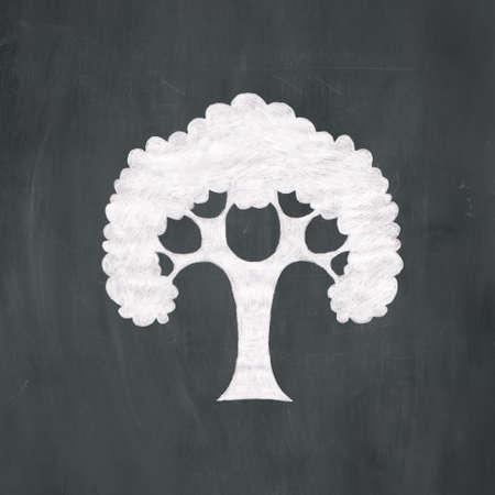 Hand-drawn illustration of a tree in white chalk on a blackboard background. Foto de archivo