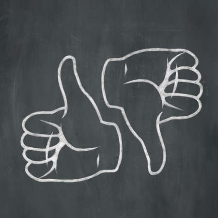 Hand-drawn illustration of a thumbs up and thumbs down in white chalk on a blackboard background. illustration