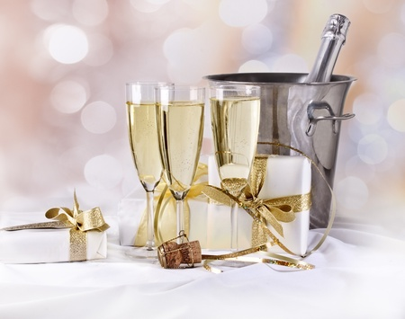 Glasses of champagne and gift photo