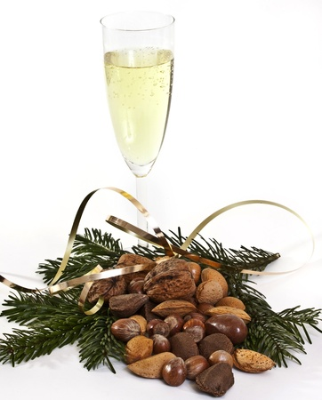 snob: Glass of champagne and nuts Stock Photo