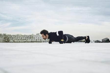 push ups: Push ups sport fitness man doing push-ups. Male athlete exercising push up outside. Healthy lifestyle concept.