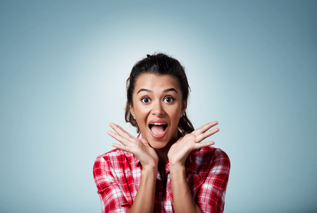 Surprise astonished beautiful mixed race woman. Closeup portrait woman surprised in full disbelief open mouth and palms isolated on background. Positive human emotion facial expression body language. Banque d'images