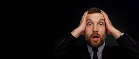 expression facial: Closeup portrait of handsome bearded businessman looking shocked, surprised in disbelief, with hands on face looking at you camera, isolated on background. Positive human emotions, facial expressions