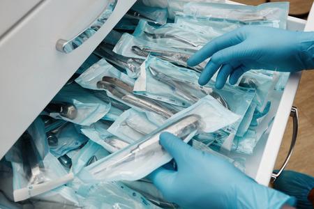 Medical laboratory technician holding a set of sterile disposable instruments Banco de Imagens