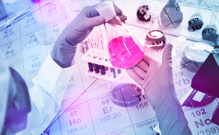 clinician: Close-up of clinician working with tools during scientific experiment in laboratory with chemical table background
