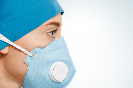 surgent: Closeup portrait of female a medical professional surgeon.