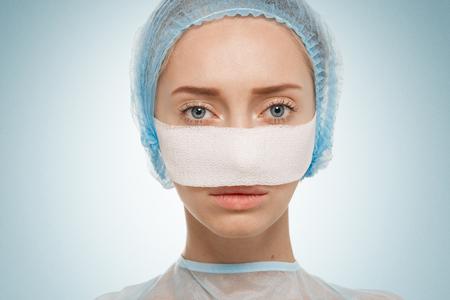 bandaged: Close-up of bandaged face after cosmetic operation