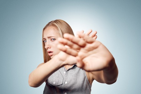 dreariness: Irritated woman showing her hand against please stop. Negative emotion facial expression feelings, signs symbols, body language