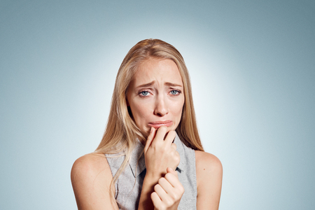 tantrum: Closeup portrait stressed frustrated woman crying or weep having temper tantrum isolated on wall background. Negative human emotion facial expression reaction attitude