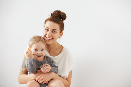 mum and child: Young attractive mother with her one years old little son dressed in pajamas. Stock Photo