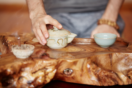 master: Chinese tea ceremony is performed by tea master at home