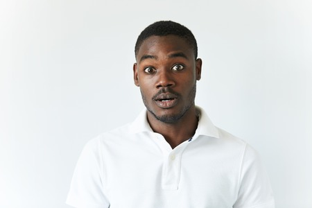 unforeseen: Human face expressions and emotions. Portrait of black student or employee, looking at the camera in complete disbelief, surprised with unexpected shocking news, with open mouth. Body language