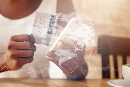 visual information: Double exposure, visual effects. Woman verifying account balance on smart phone with mobile banking application. Female hands shopping online, inputting credit card information using smart phone LANG_EVOIMAGES