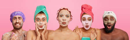 Collage shot of emotional people wear facial masks for having healthy skin and complexion, look surprisingly at camera, wash body, isolated on pink background. People, pampering, beauty treatment Фото со стока