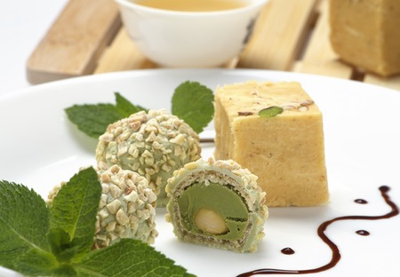 gulab: Homemade burfi - traditional indian sweets made of milk, chickpea flour, coconut flakes, cardamom and cashew nut Stock Photo