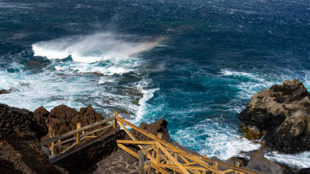 Swell in the Charco de Los Sargos, El Hierro. The waves produces a rainbow.