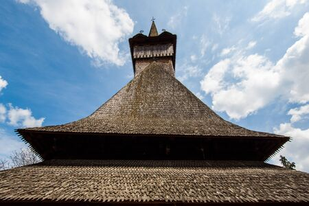 shingles: Roof with wooden shingles of a traditional romanian church in maramures