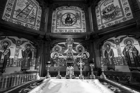 bible altar: The altar of an orthodox church in Brsana, Maramure, Romania. The church was built in the XVIII. century. Stock Photo
