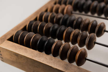Vintage wooden abacus for calculation close up on a white background